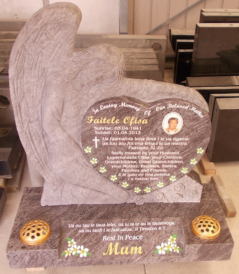 C CARVED ANGEL IN BAHAMA BLUE GRANITE ON SPLAY BASE