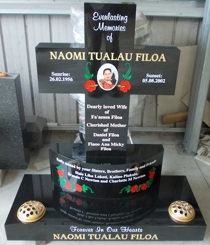 M Cross on Curved Plinth Base in black granite with Red Hibiscus flowers
